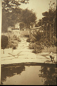 view [Rose Cove]: looking down an axial path through the opening in stucco wall to rose garden. digital asset: [Rose Cove]: looking down an axial path through the opening in stucco wall to rose garden.: [1925?]