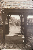 view [Rose Cove]: looking east through teahouse to formal rose beds. digital asset: [Rose Cove]: looking east through teahouse to formal rose beds.: [1925?]
