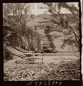 view [Unidentified Garden in New York, New York, No. 2]: seating area with wall fountain in background. digital asset: [Unidentified Garden in New York, New York, No. 2] [photonegative]: seating area with wall fountain in background.
