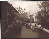 view [Unidentified Garden in New York, New York, No. 4]: raised beds, seating area, plant container, climbing plants on wall, and city view beyond. digital asset: [Unidentified Garden in New York, New York, No. 4] [photonegative]: raised beds, seating area, plant container, climbing plants on wall, and city view beyond.