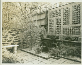 view [Unidentified Garden in New York, New York, No. 5]: wall fountain and bench, showing various wall treatments. digital asset: [Unidentified Garden in New York, New York, No. 5] [photonegative]: wall fountain and bench, showing various wall treatments.