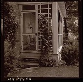view [Unidentified Garden in Armonk, New York, No. 2]: clematis and border by screen porch. digital asset: [Unidentified Garden in Armonk, New York, No. 2] [photonegative]: clematis and border by screen porch.