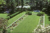 view [Erchless]: sunken garden with herbaceous borders with bathhouse to left and tennis court at top. digital asset: [Erchless]: sunken garden with herbaceous borders with bathhouse to left and tennis court at top.: 2002 Jun.