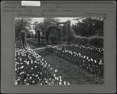 view [Breeze Hill]: grass walkway, stone walkway, and flower beds of tulips with arches. digital asset: [Breeze Hill] [photographic print]: grass walkway, stone walkway, and flower beds of tulips with arches.
