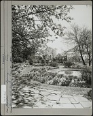 view [Breeze Hill]: Water lily pond surrounded by iris beds and stone paths. Rose arbors in the distance. digital asset: [Breeze Hill] [photographic print]: Water lily pond surrounded by iris beds and stone paths. Rose arbors in the distance.