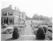 view [Chestnutwold Farm]: south side of house, showing part of the garden and the grass terrace. digital asset: [Chestnutwold Farm] [glass negative]: south side of house, showing part of the garden and the grass terrace.