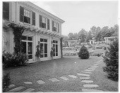 view [Chestnutwold Farm]: west end of house and stepping stone path, looking toward the formal garden and pergolas. digital asset: [Chestnutwold Farm] [glass negative]: west end of house and stepping stone path, looking toward the formal garden and pergolas.
