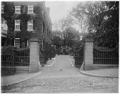 view [John Brown House]: gate and walkway on east side of house. digital asset: [John Brown House] [glass negative]: gate and walkway on east side of house.
