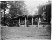 view [John Brown House]: pergola on the west side of the house. digital asset: [John Brown House] [glass negative]: pergola on the west side of the house.