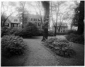 view [John Brown House]: looking across the grounds of the house toward houses on Benefit Street. digital asset: [John Brown House] [glass negative]: looking across the grounds of the house toward houses on Benefit Street.