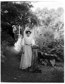 view [Miscellaneous Sites in Scotland]: an unidentified woman in an unidentified garden. digital asset: [Miscellaneous Sites in Scotland] [glass negative]: an unidentified woman in an unidentified garden.