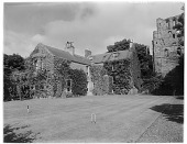 view [Miscellaneous Sites in Scotland]: Kelso Abbey, with Romanesque west tower; croquet stakes and wickets on lawn. digital asset: [Miscellaneous Sites in Scotland] [glass negative]: Kelso Abbey, with Romanesque west tower; croquet stakes and wickets on lawn.