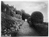 view [Drummond Castle]: looking up a sloping walkway with the castle visible on the left. digital asset: [Drummond Castle] [glass negative]: looking up a sloping walkway with the castle visible on the left.