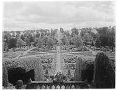 view [Drummond Castle]: looking down on part of the parterre garden, showing its primary axis and the obelisk sundial at its center. digital asset: [Drummond Castle] [glass negative]: looking down on part of the parterre garden, showing its primary axis and the obelisk sundial at its center.