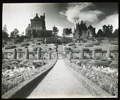 view [Drummond Castle]: looking up toward the castle from the parterre garden. digital asset: [Drummond Castle] [lantern slide]: looking up toward the castle from the parterre garden.