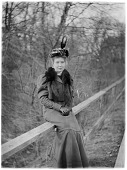 view [Miscellaneous Images]: an unidentified woman sitting on a wooden fence. digital asset: [Miscellaneous Images] [glass negative]: an unidentified woman sitting on a wooden fence.