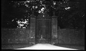 view [Unidentified Sites]: an entrance gate, probably to a country estate, in an unidentified location. digital asset: [Unidentified Sites] [negative]: an entrance gate, probably to a country estate, in an unidentified location.