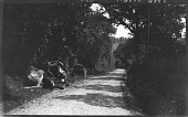 view [Unidentified Sites]: an unidentified rural location, with two men and their carts beside the road. digital asset: [Unidentified Sites] [negative]: an unidentified rural location, with two men and their carts beside the road.