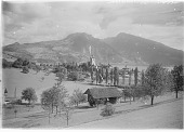 view [Miscellaneous Sites in Switzerland]: looking toward Spiez Castle, with the Ralligstock (left) and Niederhorn (right) in the distance across the Thunersee. digital asset: [Miscellaneous Sites in Switzerland] [glass negative]: looking toward Spiez Castle, with the Ralligstock (left) and Niederhorn (right) in the distance across the Thunersee.