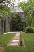 view [Woods' Côte]: square flagstone stepping stones lead across front of house to patio. digital asset: [Woods' Côte]: square flagstone stepping stones lead across front of house to patio.: 2005 Jun.