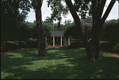 view [Ravenwood]: a wooden gazebo amidst lawn and trees. digital asset: [Ravenwood]: a wooden gazebo amidst lawn and trees.: 1999 Aug.