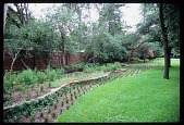 view [Harlan Crow Garden]: contoured beds and a brick wall were added to the front yard in 2010. digital asset: [Harlan Crow Garden]: contoured beds and a brick wall were added to the front yard in 2010.: 2012 Apr.