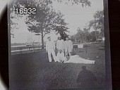 "view [Miscellaneous Images in Virginia]: an unidentified group of five men, possibly sailors, on a lawn with a ""tall ship"" in the background. digital asset: [Miscellaneous Images in Virginia] [nitrate negative]: an unidentified group of five men, possibly sailors, on a lawn with a ""tall ship"" in the background."