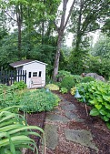 view [Jones Garden]: a lighted stone path leads to the potting shed, previously a children's playhouse. digital asset: [Jones Garden]: a lighted stone path leads to the potting shed, previously a children's playhouse.: 2015 Jun.