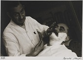 view Untitled--Man Getting a Shave, from the portfolio Photographs of New York digital asset number 1