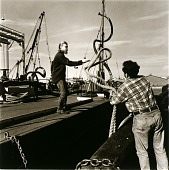 view Harry Keeler and John Brown are securing an oil barge to the tugboat so that it can be towed out to refuel an oceangoing vessel digital asset number 1