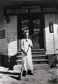 """view The Mancrini Store, 1627 Ball. Mister Henry Mancrini circa 1940, from """"The Corner Stores of Galveston,"""" Galveston County Cultural Arts Council digital asset number 1"""