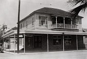 """view Stiglich Grocery, 2728 Avenue Q. Two people barely seen on upper porch, 1936, from """"The Corner Stores of Galveston,"""" Galveston County Cultural Arts Council digital asset number 1"""