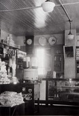 """view Stiglich Grocery, 2728 Avenue Q. Interior, 1932, from """"The Corner Stores of Galveston,"""" Galveston County Cultural Arts Council digital asset number 1"""