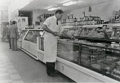 """view Louis Menotti at semi-self-service counter, first in Galveston, 1949, from """"The Corner Stores of Galveston,"""" Galveston County Cultural Arts Council digital asset number 1"""