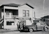 """view R. Carmignani family in front of store at 1502 13th Street, Galveston, 1950, from """"The Corner Stores of Galveston,"""" Galveston County Cultural Arts Council digital asset number 1"""