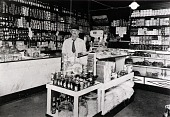 """view Queen's Grocery, 35th and Avenue S, 1934 or 1935, from """"The Corner Stores of Galveston,"""" Galveston County Cultural Arts Council digital asset number 1"""