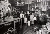 """view Mencacci Family in store at 21st Street and Avenue O 1/2, ca. 1910, from """"The Corner Stores of Galveston,"""" Galveston County Cultural Arts Council digital asset number 1"""