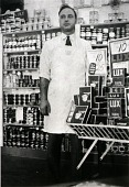 """view Henry Macrini in his store at 1627 Avenue H, 1934 or 1935, from """"The Corner Stores of Galveston,"""" Galveston County Cultural Arts Council digital asset number 1"""