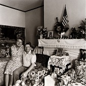 view Vera and Michael Shashko in the Living Room of their Bank Street Home, from the East Baltimore Documentary Survey Project digital asset number 1