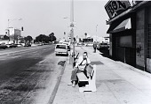 view Public Transit Areas, Ocean and Pacific Ave., Looking East, from the Long Beach Documentary Survey Project digital asset number 1