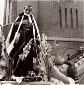 view The celebration of St. Gabriel's Day began in Abruzzo, Italy as a result of a young seminarian's death a few months before he was to be ordained. Money is pinned to the statue as it is wheeled through the streets of Little Italy digital asset number 1