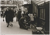 view Untitled--Man with Newspaper Getting a Shoe Shine, from the portfolio Photographs of New York digital asset number 1