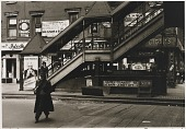 """view Untitled--Man in Overcoat near Steps to """"El"""", from the portfolio Photographs of New York digital asset number 1"""
