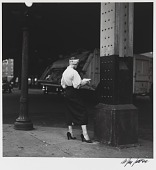 view Woman Reading Paper Under the El digital asset number 1
