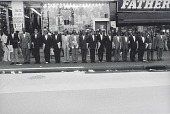 view Untitled NYC (125th Street) (group of men on curb, wearing suits...), from the series Hats and Hat Nots digital asset number 1
