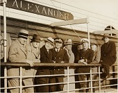 view Unidentified men in suits leaning on a ship railing digital asset number 1