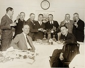 view Unidentified group of men, toasting and shaking hands digital asset number 1