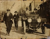 view Lee Athey, Johnny Kilbane, Jimmy Dunn with unidentified men running alongside car digital asset number 1
