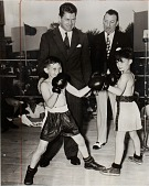 view Gene Tunney (left) and Arthur Donovan (right) with young boxers Edward McDermott and William McClure at World's Fair digital asset number 1