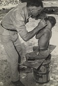 view Tobacco Farmer Cutting Hair, N.C. digital asset number 1